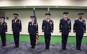 Six newly inducted ceremonial guardsmen stand at attention during the 911th Airlift Wing base honor guard graduation ceremony at the Pittsburgh International Airport Air Reserve Station, Pennsylvania, Dec. 8, 2019.