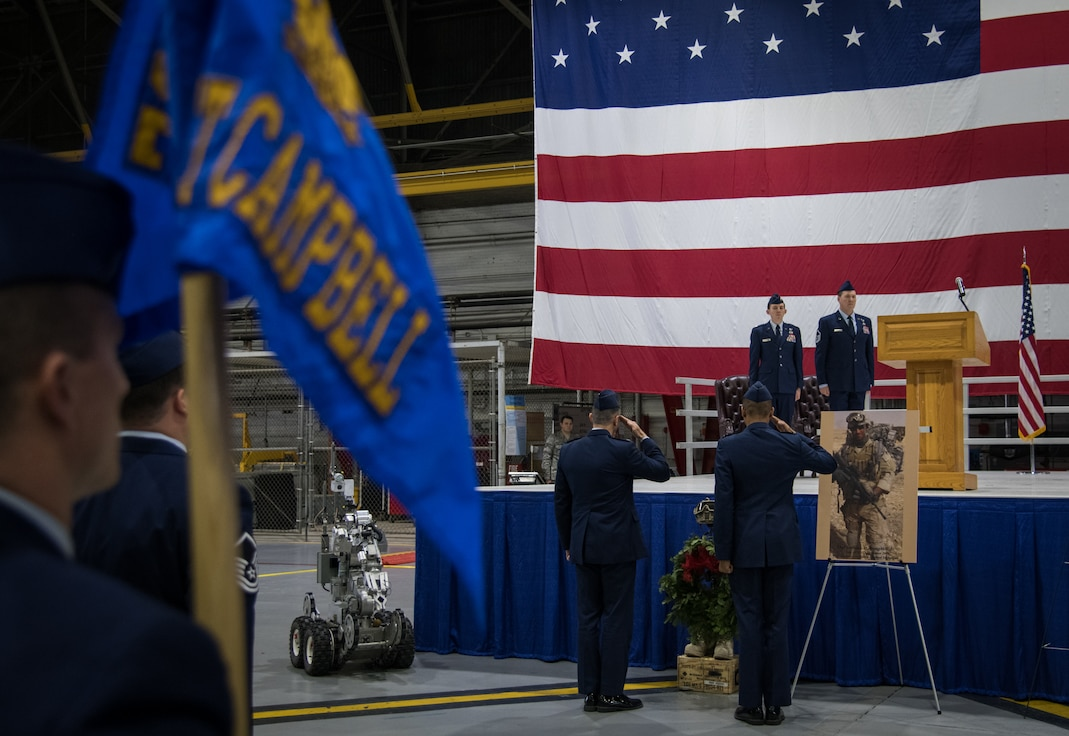 """Col. Glenn Collins, 932nd Airlift Wing commander, and Col. Lance Turner, 932nd Mission Support Group commander, render a salute during a 10-year commemoration ceremony in honor of Tech. Sgt. Anthony Campbell, fallen 932nd Explosive Ordnance Disposal technician, Jan. 12, 2020, at Scott Air Force Base, Illinois. Campbell was killed in action Dec. 15, 2009,in Helmand Province, Afghanistan, while serving with the 755th Bravo EOD Flight. """"Tech. Sgt. Tony Campbell's passing in 2009 was a tremendous loss for the EOD community, the reverberations of which are still felt today. He died doing what he loved, protecting his nation and his brothers, and he left behind a beautiful legacy that we must never forget. It is our solemn duty to remember Tony, to honor his sacrifice, and to pay tribute to his family. Today's ceremony was our most humble attempt to do just that,"""" said Maj. Daniel Myatt, 932nd EOD flight commander. (U.S. Air Force photo by Master Sgt. Christopher Parr)"""