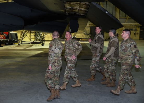 Air Force Chief of Staff Gen. David L. Goldfein looks under the wing of a B-52H Stratofortress at Minot Air Force Base, N.D., Jan. 2, 2020. During his visit, Goldfein showed appreciation to Minot AFB Airmen for their efforts and sacrifice. (U.S. Air Force photos by Airman 1st Class Caleb S. Kimmell)
