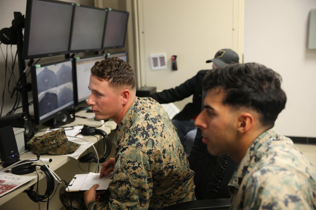 U.S. Marines monitor Marines conducting a combat convoy simulation on Marine Corps Base Camp Pendleton, California, Nov. 13.