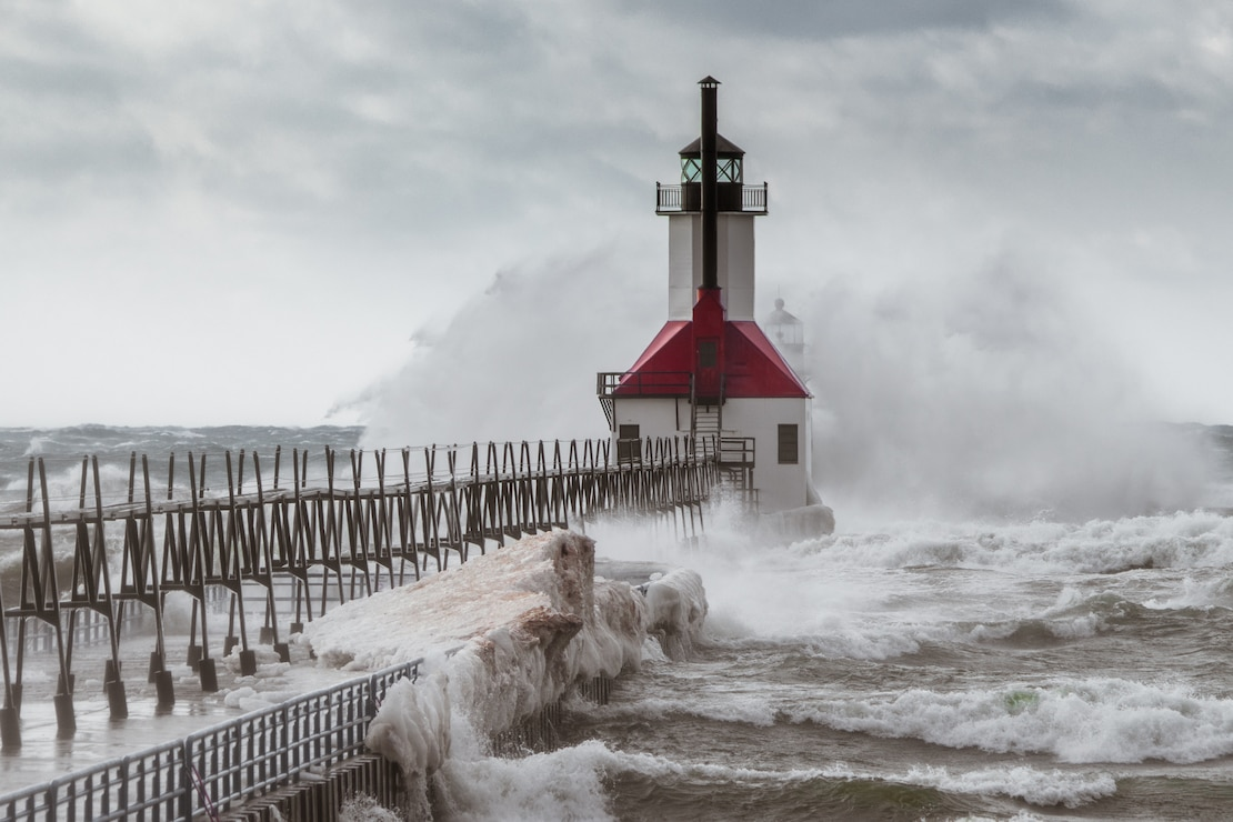 Waves wash over the pier at St. Joseph Harbor in Michigan, photo by Peter Brown.