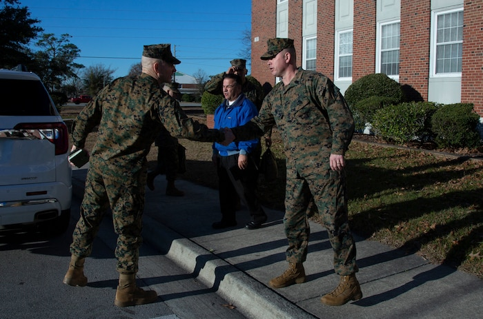 U.S. Marine Corps Sgt. Maj. Troy E. Black, left, the 19th sergeant major of the Marine Corps, greets Sgt. Maj. Bobby D. Frazier, right, sergeant major for Headquarters and Support Battalion, Marine Corps Installations East - Marine Corps Base Camp Lejeune, during a visit to MCB Camp Lejeune, North Carolina, Jan. 08, 2020. Black visited for familiarization with the current posture of Installation services, health and welfare of the service members, government employees and families within prIvatized military housing. (U.S. Marine Corps photo by Cpl. Dominique Osthoff)