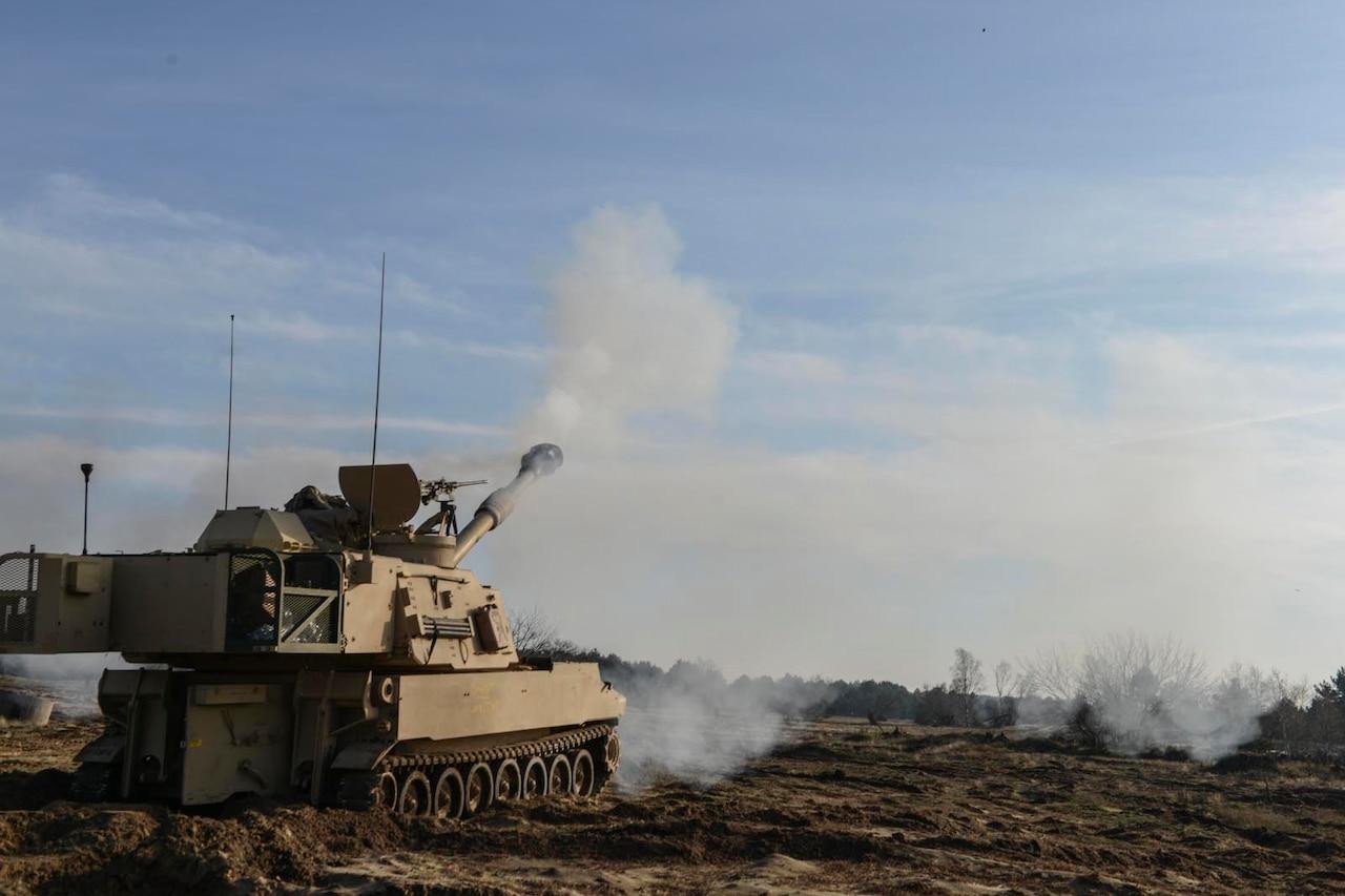 Tank fires round.