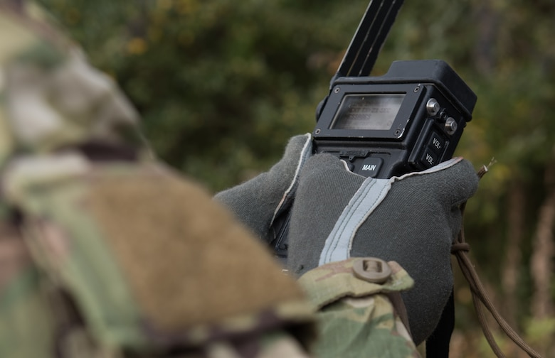 U.S. Air Force Tech. Sgt. Stephen Drakes, 192 Operations Support Squadron, Virginia Air National Guard SERE Survival, Evasion, Resistance and Escape non-commissioned officer in charge, sets a survival radio during a training at Joint Base Langley-Eustis, Virginia, Dec. 12, 2019. Drakes led the training which taught survival skills necessary for an isolation situation. (U.S. Air Force photo by Airman 1st Class Sarah Dowe)