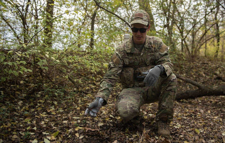 U.S. Air Force Tech. Sgt. Stephen Drakes, 192 Operations Support Squadron, Virginia Air National Guard SERE Survival, Evasion, Resistance and Escape non-commissioned officer in charge, demonstrates camouflaging techniques during a training at Joint Base Langley-Eustis, Virginia, Dec. 12, 2019. Drakes led the training which taught survival skills necessary for an isolation situation. (U.S. Air Force photo by Airman 1st Class Sarah Dowe)