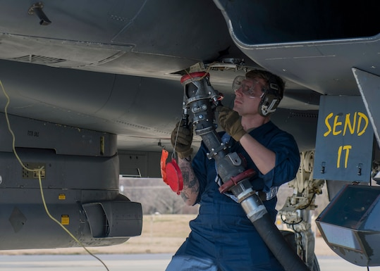 Airmen from the 4th Logistics Readiness Squadron, Petroleum, Oil and Lubricants (POL) shop and 336th Aircraft Maintenance Unit (AMU) work together to conduct hot-pit refueling of F-15E Strike Eagles at Seymour Johnson Air Force Base, North Carolina.