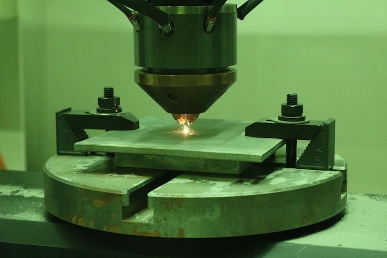 NAWCAD Lakehurst engineers conduct bead on plate trials on the Optomec CS-800 DED System at Joint Base McGuire-Dix-Lakehurst, New Jersey. The newly acquired system is part of the 2019 expansion of Additive Manufacturing capabilities at NAWCAD Lakehurst.