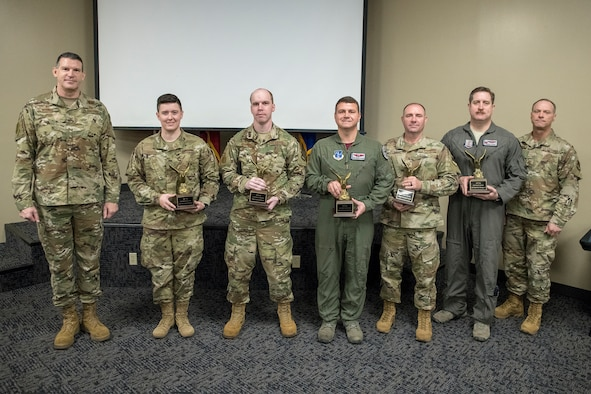 The 188th Wing's Outstanding Airmen of the Year pose for a photo with wing leadership during a recognition ceremony at Ebbing Air National Guard Base, Ark., Jan 11, 2020. From left, Col. Leon Dodroe, 188th Wing commander, Senior Airman Hannah Martin, Outstanding Junior Enlisted Airman of the Year, Tech. Sgt. Justin Brown, Outstanding NCO of the Year; Senior Master Sgt. Michael Wilmouth, Outstanding Senior NCO of the Year; Master Sgt. Timothy Curd, Outstanding First Sergeant of the Year; Lt. Col. Douglas Olson, 188th Operations Group Director of Operations, accepting on behalf of Maj. Seth Simpson, Outstanding Field Grade Officer of the Year; Chief Master Sgt. Donnie Frederick, 188th Wing Command Chief Master Sergeant. Not pictured is Capt. Logan Huffman, Outstanding Company Grade Officer of the Year. (U.S. Air National Guard photo by Airman 1st Class Christopher Sherlock)