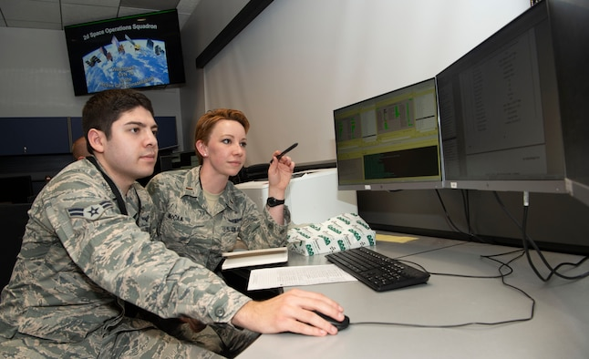 SCHRIEVER AIR FORCE BASE, Colo. – Second Lt. Kelley McCaa, 2nd Space Operations Squadron satellite vehicle operator, and Airman 1st Class John Garcia, 2nd SOPS satellite systems operator, set satellite vehicle number-74, the first iteration of GPS Block III vehicles, as healthy and active to users Jan. 13, 2020, Schriever Air Force Base, Colorado,. Setting the vehicle healthy and active makes the satellite available for use by military and civilian GPS users around the world for agriculture, banking and navigation. (U.S. Air Force photo by Staff Sgt. Matthew Coleman-Foster)