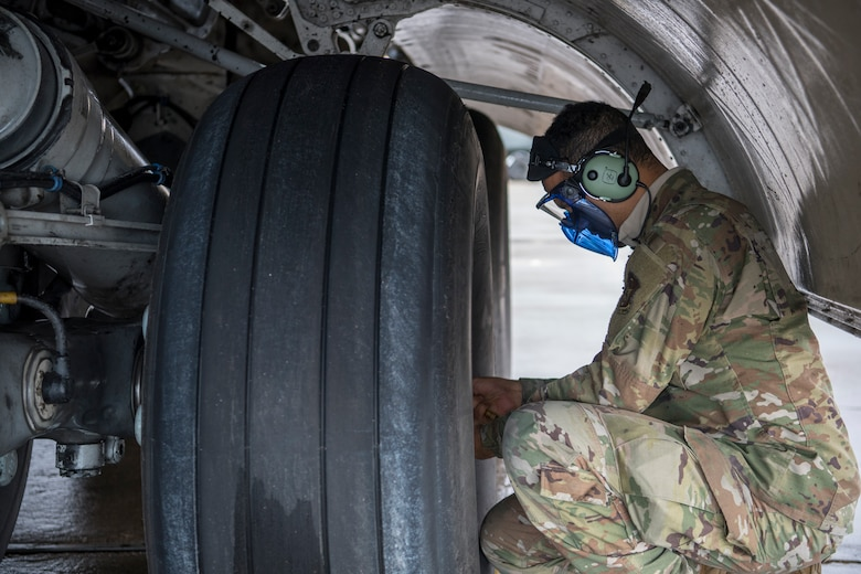 U.S. Air Force Staff Sgt. Matthew F. Varela, 514th Aircraft Maintenance Squadron crew chief with the 514th Air Mobility Wing, Joint Base McGuire-Dix-Lakehurst, N.J., checks the tire pressure on a C-17 Globemaster III after it arrives at Holloman Air Force Base, N.M., Jan. 10, 2020. Airmen from the 514th AMXS joined members from the 732nd Airlift Squadron, as they flew a sortie to Naval Air Station Key West, Fla. (U.S. Air Force photo by Senior Airman Ruben Rios)