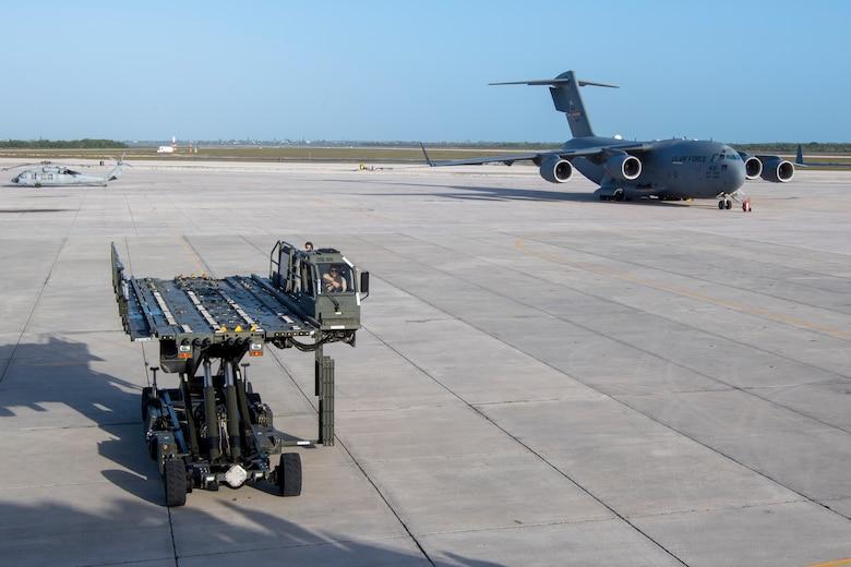 U.S. Air Force Staff Sgt. Andrekim S. Pangalangan, a 35th Aerial Port Squadron, air transportation specialist with the 514th Air Mobility Wing, Joint Base McGuire-Dix-Lakehurst, N.J., drives a Halvorsen Loader to the door of a KC-10 on the Naval Air Station Key West, Fla., flight line, Jan. 11, 2020. Reserve Citizen Airmen from the 78th Air Refueling Squadron with the 514th AMW, flew the KC-10 Extender to NASKW to transport cargo and personnel. (U.S. Air Force photo by Senior Airman Ruben Rios