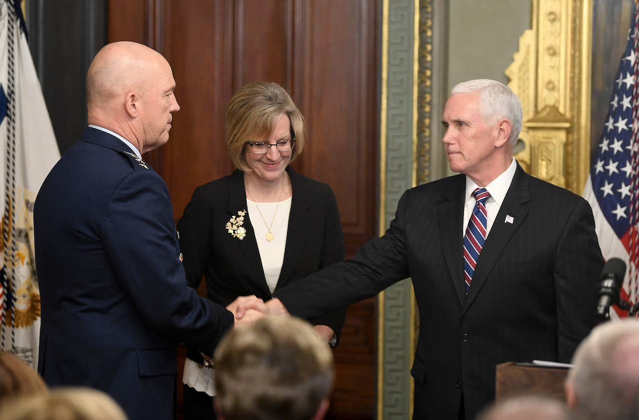 Vice President Mike Pence shakes another person's hand.