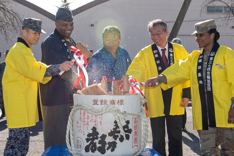 Yokota leadership breaks open a sake barrel along with the Japanese Welfare Association, Japan Air Self-Defense Force and Yokota Defense Office's leaders during the JWA New Year Fest, Jan.10, 2020, at Yokota Air Base, Japan.