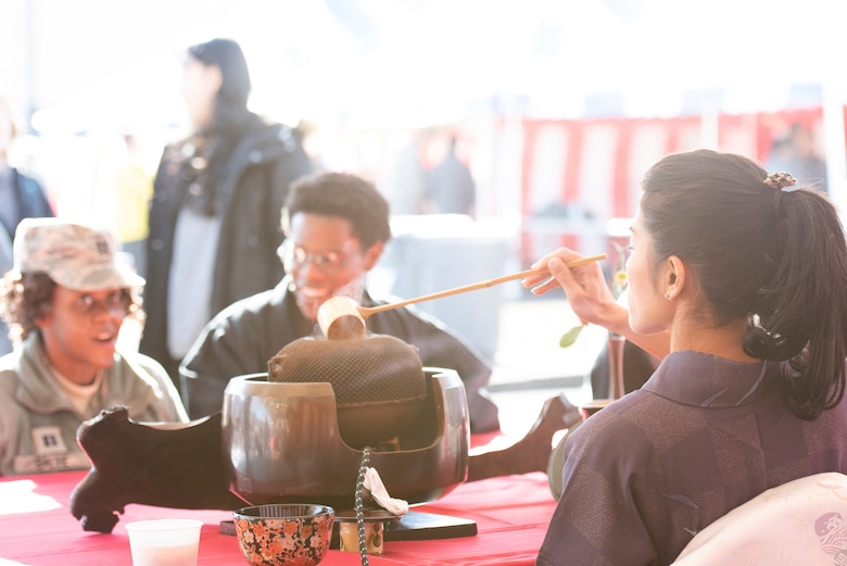 A Japanese employee prepares Matcha green tea for festival attendees during the New Year Fest hosted by the Japanese Welfare Association, Jan.10, 2020, at Yokota Air Base, Japan.