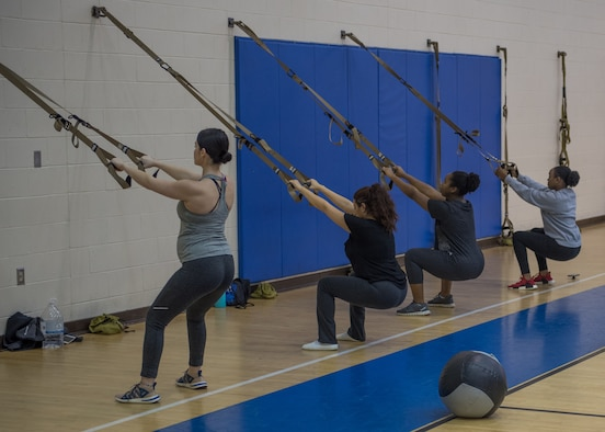 Participants in the prenatal fitness class perform TRX squats at Joint Base Langley-Eustis, Virginia, Jan. 13, 2020.