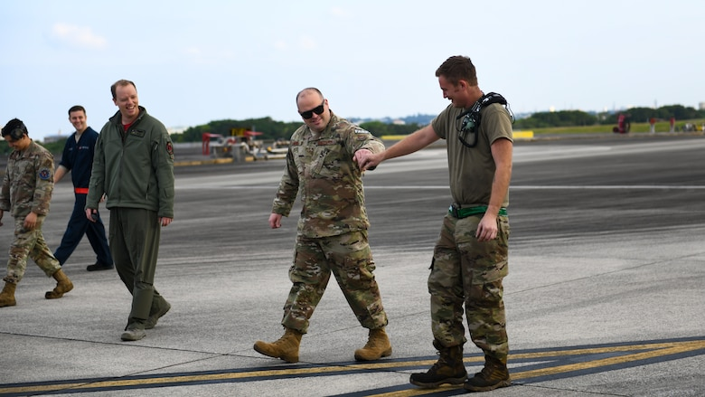 Maintainers from the 18th Aircraft Maintenance Squadron, 67th Aircraft Maintenance Unit, conduct a walk for foreign object debris during Exercise Rumrunner at Marine Corps Air Station Futenma, Japan, Jan. 10, 2020. The 18th Wing and its joint partners executed the first WestPac Rumrunner exercise, which focused on defensive counter air capabilities and joint interoperability using agile combat employment concepts. (U.S. Air Force photo by Staff Sgt. Benjamin Raughton)