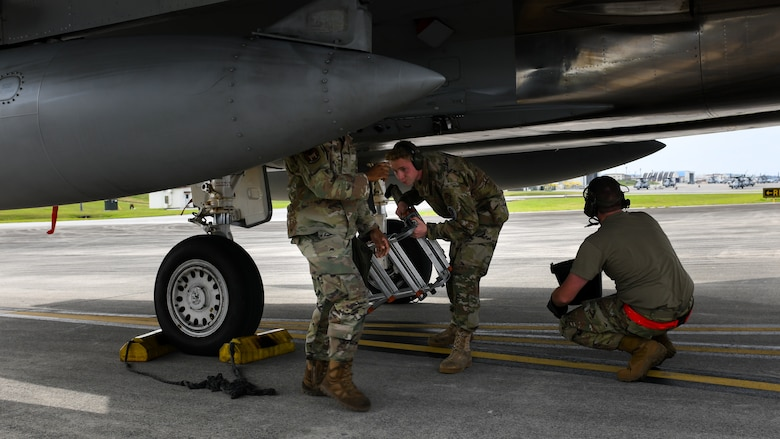 Maintainers from the 18th Aircraft Maintenance Squadron, 67th Aircraft Maintenance Unit, practice de-arming an F-15C Eagle during Exercise Rumrunner at Marine Corps Air Station Futenma, Japan, Jan. 10, 2020. The 18th Wing and its joint partners executed the first WestPac Rumrunner exercise, which focused on defensive counter air capabilities and joint interoperability using agile combat employment concepts. (U.S. Air Force photo by Staff Sgt. Benjamin Raughton)