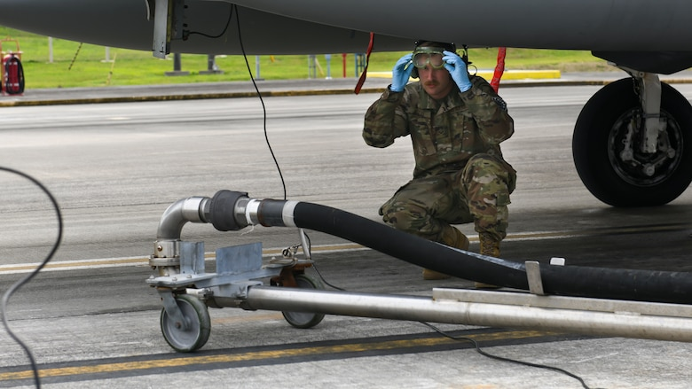 A maintainer from the 18th Aircraft Maintenance Squadron prepares to fuel an F-15C Eagle during Exercise Rumrunner at Marine Corps Air Station Futenma, Japan, Jan. 10, 2020. The 18th Wing and its joint partners executed the first WestPac Rumrunner exercise, which focused on defensive counter air capabilities and joint interoperability using agile combat employment concepts. (U.S. Air Force photo by Staff Sgt. Benjamin Raughton)