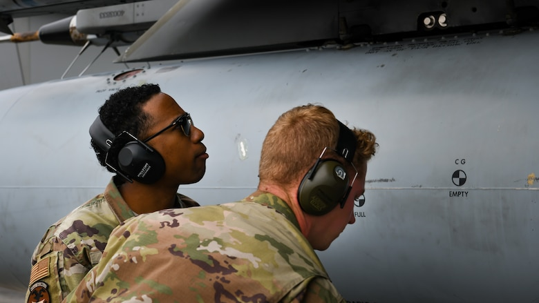 Maintainers from the 18th Aircraft Maintenance Squadron inspect an F-15C Eagle during Exercise WestPac Rumrunner at Marine Corps Air Station Futenma, Japan, Jan. 10, 2020. The 18th Wing and its joint partners executed the first WestPac Rumrunner exercise, which focused on defensive counter air capabilities and joint interoperability using agile combat employment concepts. (U.S. Air Force photos by Staff Sgt. Benjamin Raughton)