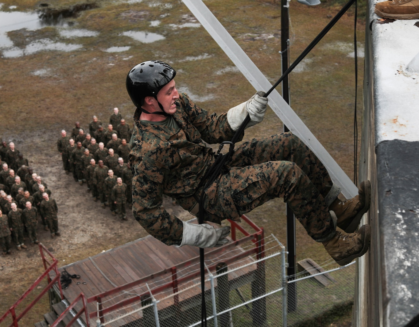 Recruits with Bravo Company, 1st Recruit Training Battalion, go down the rappel tower at Marine Corps Recruit Depot Parris Island, S.C., Dec. 30, 2019. The rappel tower is a training event designed to instill confidence and eliminate fear of heights within recruits. (U.S. Marine Corps photo by Lance Cpl. Godfrey Ampong)