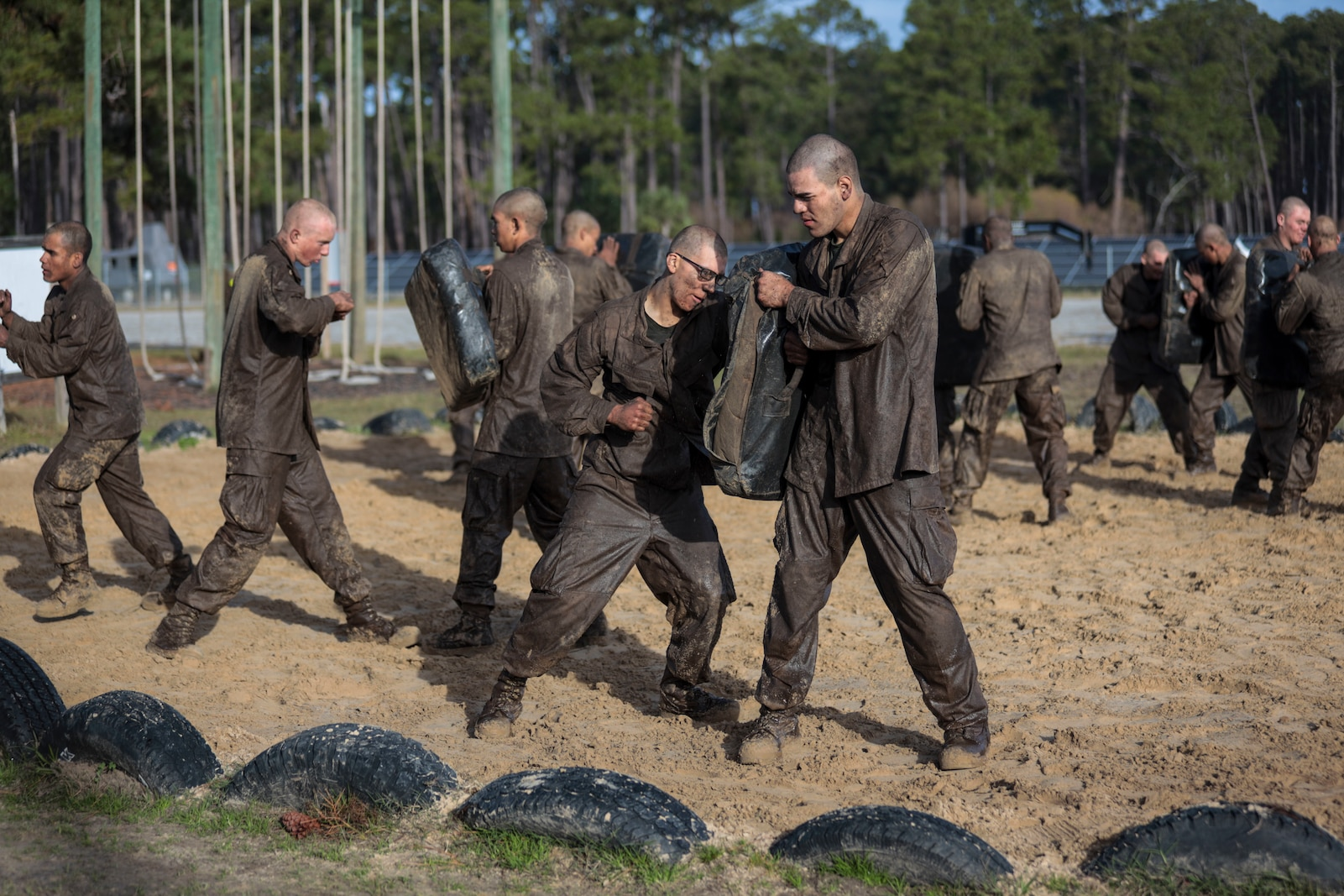Recruits with Hotel Company, 2nd Recruit Training Battalion, participate in a Crucible event at Marine Corps Recruit Depot Parris Island, South Carolina, Jan. 10, 2020. The Crucible is a 54-hour field training exercise that presents continuous physical and mental challenges. (U.S. Marine Corps photo by Lance Cpl. Christopher McMurry)