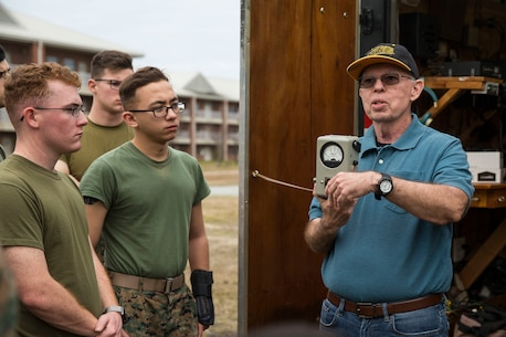 (Right) Dave Wood, president of the Brightleaf Amateur Radio Club instructs U.S. Marines with 2nd Radio Battalion and 8th Communication Battalion, II Marine Expeditionary Force Information Group, on amateur radios during a HAM Amateur Radio Licensing Course at Camp Lejeune, N.C., Jan. 10, 2020. The objective of the course was to increase knowledge on amateur radios and radio operating procedures in order to develop and enhance the Marines' capabilities. (U.S. Marine Corps photo by Lance Cpl. Larisa Chavez)