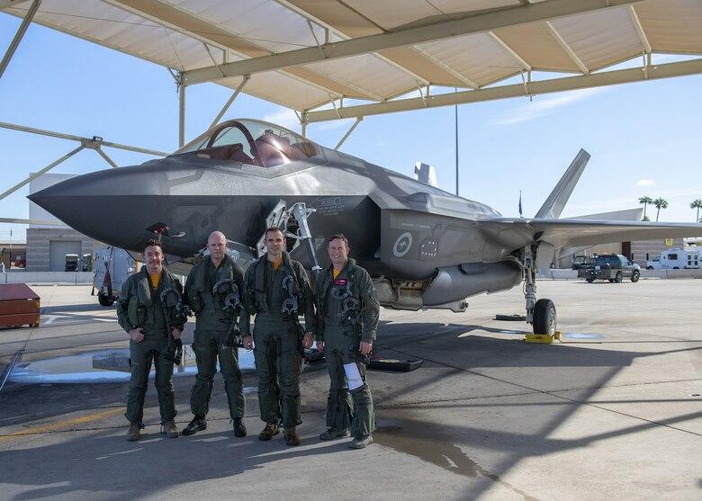 Royal Australian air force pilots pose following their final training flight at Luke Air Force Base Nov. 22, 2019, at Luke AFB, Ariz.