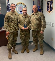 Col. Stryder Sulley, Staff Sgt. Alan Dwyer and Lt. Col William Wilson, Pease Air National Guard Base, N.H. on Dec. 7, 2019. Sulley presented Dwyer with the 2019 Gen. John P. Jumper Award for Excellence in Warfighting Integration and Information Dominance during the 157th Communications' unit training assemply roll call. The award recognizes the best and brightest Airmen, teams, and units for their sustained superior performance in providing information dominance and cyberspace superiority to Air Force and (or) DoD missions and operations.(Photo courtesy 157th Communications Flight)