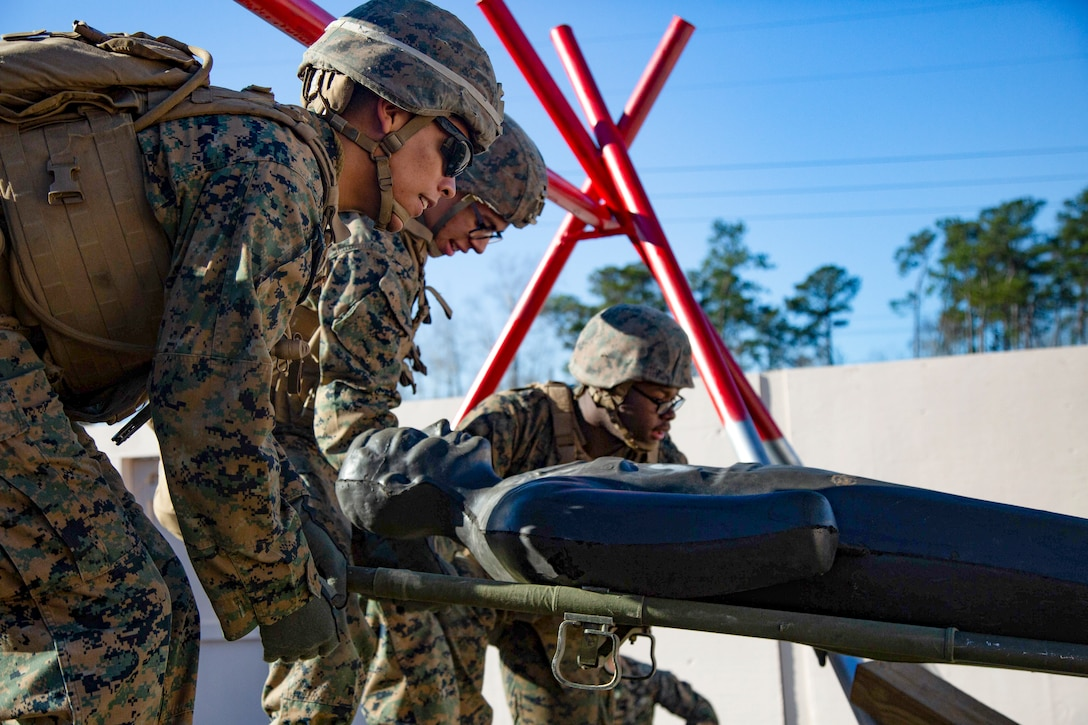 U.S. Marines work together on an obstacle at the Leadership Reaction Course on Marine Corps Base Camp Lejeune, North Carolina, Jan. 7.