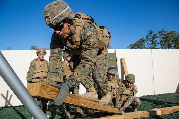U.S. Marines with 2nd Assault Amphibian Battalion, 2nd Marine Division, work together on an obstacle at the new Leadership Reaction Course (LRC) on Marine Corps Base Camp Lejeune, North Carolina, Jan. 7, 2020.