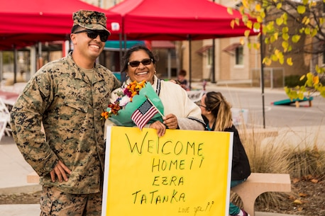 U.S. Marine Corps Sgt. Erza Atencio, Combat Logistics Battalion 11 (CLB-11), 11th Marine Expeditionary Unit, reunites with his mother during a homecoming on Camp Pendleton, California, Nov. 26, 2019.