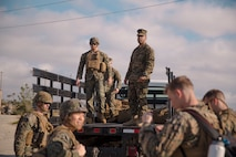 U.S. Marines with the Combat Logistics Battalion 11 (CLB-11), 11th Marine Expeditionary Unit, unload gear during a homecoming on Camp Pendleton, California, November 26, 2019.
