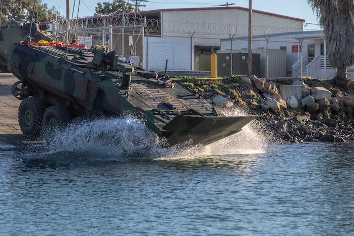 U.S. Marines with Amphibious Vehicle Test Branch, Marine Corps Tactical Systems Support Activity, test Amphibious Combat Vehicles along the beach during low-light surf transit testing at AVTB Beach on Marine Corps Base Camp Pendleton, California, Dec. 16, 2019