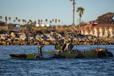 U.S. Marines with Amphibious Vehicle Test Branch, Marine Corps Tactical Systems Support Activity, test Amphibious Combat Vehicles along the beach during low-light surf transit testing at AVTB Beach on Marine Corps Base Camp Pendleton, California, Dec. 16, 2019.