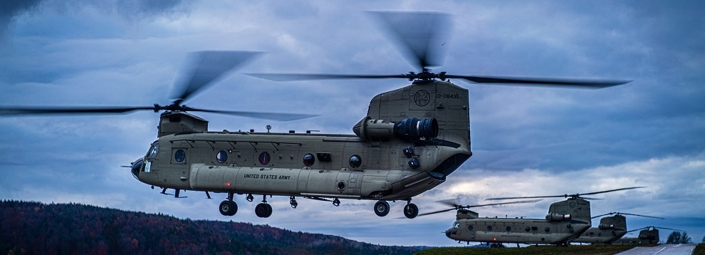 Two CH-47 Chinooks from 1-214th Aviation Regiment  land at battalion headquarters on the evening of Nov. 6 at Hohenfels Training Area during Dragoon Ready 20.