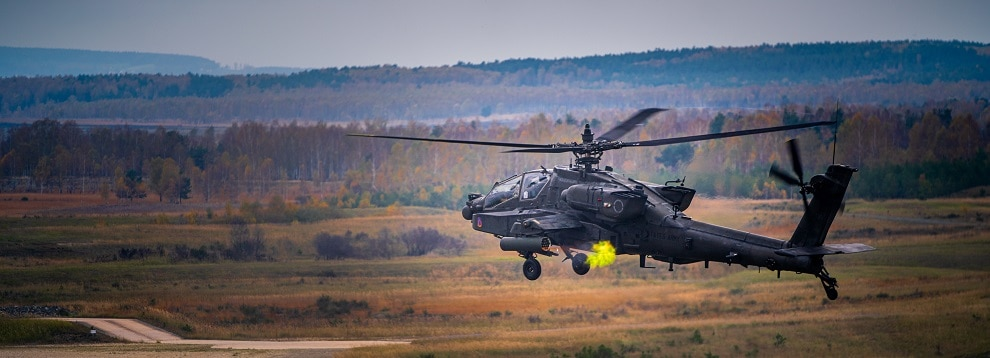 An AH-64 from Charlie Company, 1-3rd Attack Reconnaissance Battalion fires a rocket during live fire training at Grafenwoehr training area.