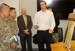 Army Sgt. Majs. Fu Pi, far left, and Marco Torres, second from left, listen as DLA Troop Support Clothing and Textiles Director of Supplier Operations Steve Merch provides information on C&T's ongoing efforts in support of Army uniforms Jan. 10, 2020, in Philadelphia. Torres, newly assigned Command Sgt. Maj. of Army Sustainment Command, was educated on the logistics and sustainment support DLA Troop Support provides in partnership with its Army customers.