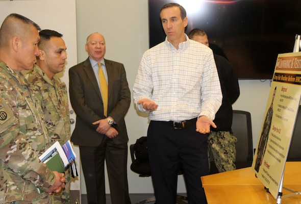Army Sgt. Majs. Fu Pi, far left, and Marco Torres, second from left, listen as DLA Troop Support Clothing and Textiles Director of Supplier Operations Steve Merch provides information on C&T's ongoing efforts in support of Army uniforms Jan. 10, 2020, in Philadelphia.