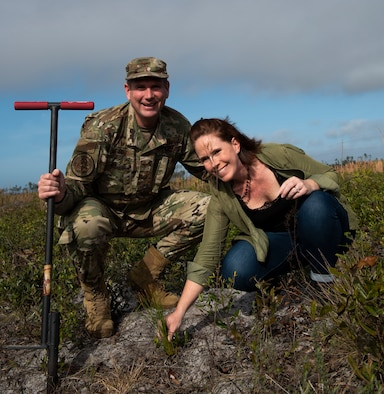 U.S. Air Force Col. Gregory Beaulieu, 325th Mission Support Group commander poses for a photo with his spouse, Amy, at Tyndall Air Force Base, Florida, Jan 15, 2020. The couple planted a longleaf pine tree as part of a long term, large scale project to restore Tyndall's ecosystem after the devastation caused by Category 5 Hurricane Michael in 2018. (U.S. Air Force photo by Staff Sgt. Magen M. Reeves)