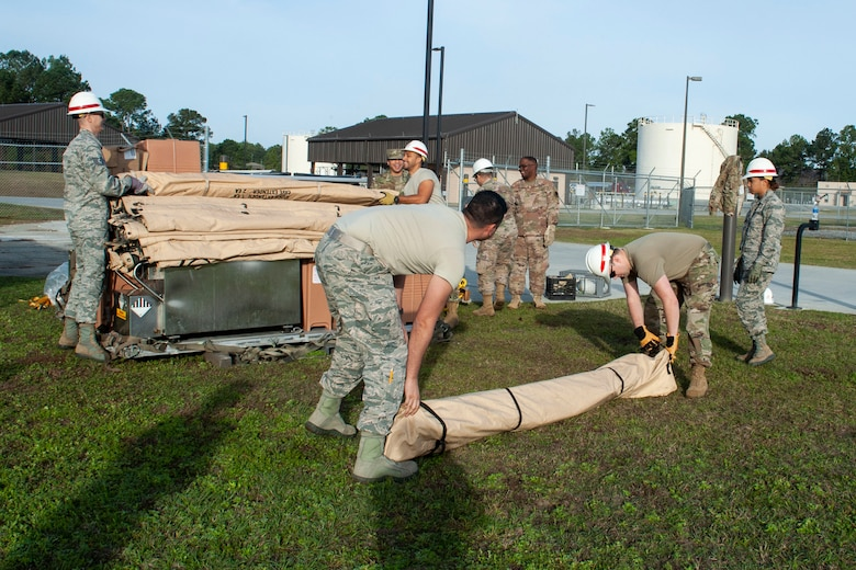Photo of Airmen setting up a Temper Tent
