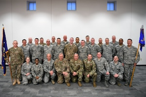 Members, assigned to the Ohio Air National Guard's 251st Cyberspace Engineering and Installation Group, pose for group photo at Springfield-Beckley Air National Guard Base. The 251 CEIG was awarded the 2019 Maj. Gen. Harold M. McClelland Award for providing engineer and extended communication capabilities in support of worldwide operations. (U.S. Air National Guard photo by Staff Sgt. Rachel Simones)