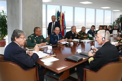 Colombian Minister of Defense Carlos Holmes Trujillo and U.S. Navy Adm. Craig S. Faller meet at a table.