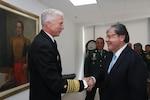 Colombian Minister of Defense Carlos Holmes Trujillo greets U.S. Navy Adm. Craig S. Faller.