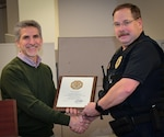 Sgt. Jeffrey LeMasters (right) receives a certificate for 35 years of federal service from Defense Logistics Agency Installation Management Susquehanna Site Director Rob Montefour during a December 2019 roll-call. LeMasters began his federal career when he enlisted in the U.S. Navy as a religious programs specialist in 1980. (Photo by Diana Dawa, DLA Distribution Public Affairs)