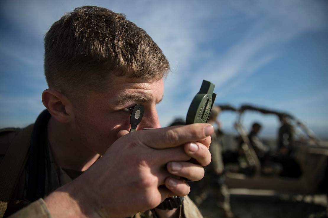 U.S. Marine shoots an azimuth with a lensatic compass during a land navigation evaluation on Marine Corps Base Camp Pendleton, California, Jan. 15.