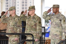 (From left) Maj. Gen. Dennis P. LeMaster, Lt. Gen. James E. Rainey and Maj. Gen. Patrick D. Sargent salute the national colors during the playing of the national anthem during the U.S. Army Medical Center of Excellence change of command ceremony at Joint Base San Antonio-Fort Sam Houston Jan. 10.