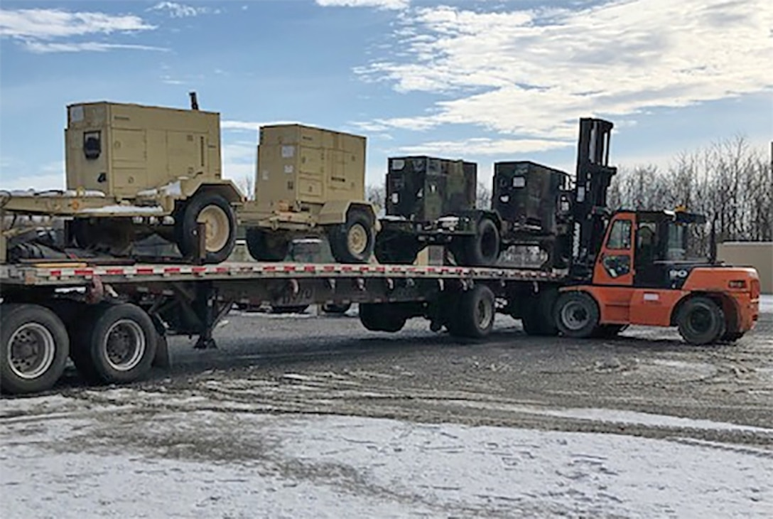 A DLA Disposition Services forklift driver prepares diesel generators for transport to the Bahamas.