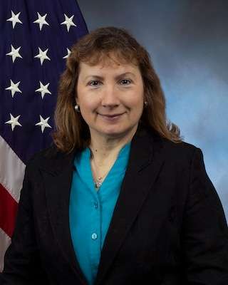 Official photo in front of American flag and blue background