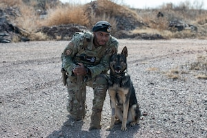 A security forces member with their military working dog