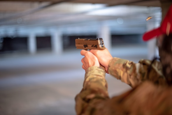 Tech. Sgt. Matt Leake, 22nd Security Forces Squadron combat arms and maintenance instructor, fires an M18 pistol Jan. 10, 2019, at McConnell Air Force Base, Kansas. Defenders are adopting the handgun to enhance base security with modern firearm technology. (U.S. Air Force photo by Staff Sgt. Chris Thornbury)